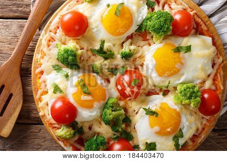 Hearty Breakfast Of Pizza With Eggs, Broccoli, Tomatoes Closeup On The Table. Horizontal Top View