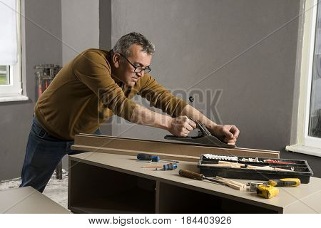 Carpenter Using Wood Planer
