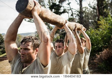 Soldiers carrying a tree log in boot camp