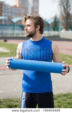Guy With Muscular Body, Beard Holding Yoga Or Fitness Mat