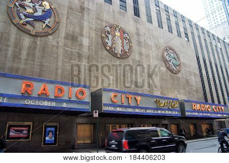 New York USA - November 13 2008: exterior wall of radio city music hall theater building modern architecture with billboards on grey background. Entertainment and tourist destination