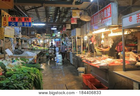 TAICHUNG TAIWAN - DECEMBER 9, 2016: Unidentified people visit Third market. Third market is a local street market.