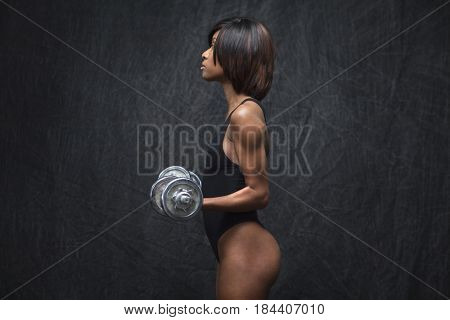 Black woman using hand weights