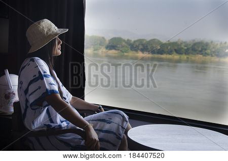 Alone Thai Woman Sitting On Chair Looking View Landscape And Flowing Of Mae Khong River