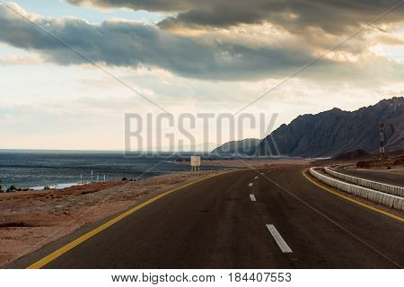 Asphalt road in desert near Red sea Dahab, Egypt