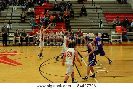 shooting basketball, boys basketball game, Pandora Gilboa High School verses Leipsic High School, Pandora, Ohio, December 26th, 2015