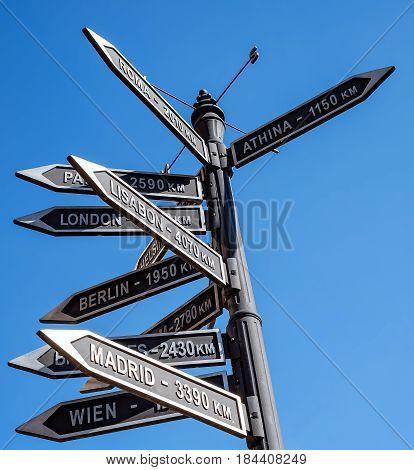 City sign indicator on blue sky .