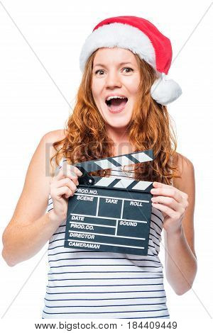 Shocked Emotional Girl In Santa Hat With A Movie Clapper