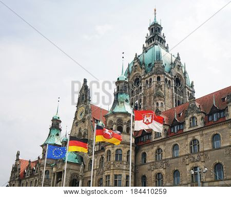 New Town Hall in Hannover, Germany, with flags of Europe, Germany, Lower Saxony and Hannover city