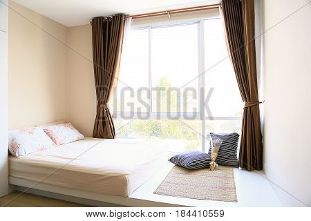 Relax corner and interior with warm light from the sun. Relax day in bedroom on free day. Feeling relax and feeling enjoy on the bed in modern bedroom. modern interior and furniture in home.