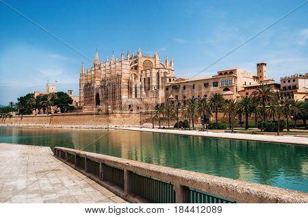 Park de la Mar against La Seu the gothic medieval cathedral of Palma de Mallorca Spain. The Cathedral of Santa Maria of Palma