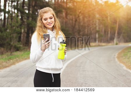 Enjoy The Running. Portrait Of Cheerful And Attractive Redhaired Sports Girl Listening Music While H