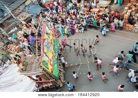 KOLKATA WEST BENGAL INDIA - 12TH AUGUST 2012 : Religious Hindu devoteed pulling ropes of procession Lord Ram. Ram is a Hindu God based on whose life epic story