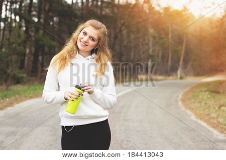 Happy Workout. Portrait Of Attractive And Cheerful Redhaired Sports Girl Listening Music While Stand
