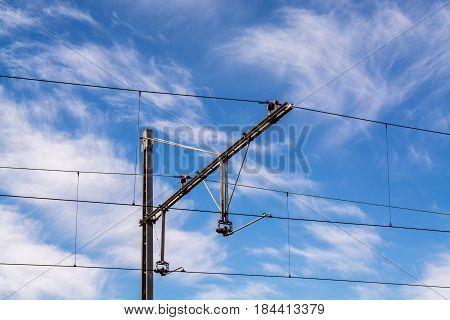 railway cable tracks against hazy blue sky