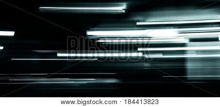 Platinum light trails on black background .