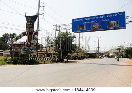 Big Phi Ta Khon Figure Symbol Of Dan Sai With Information Board With Traffic Road