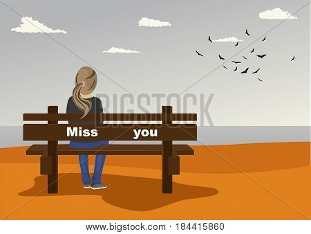 Rear view of young woman sitting on bench on the seashore with miss you text on it in autumn
