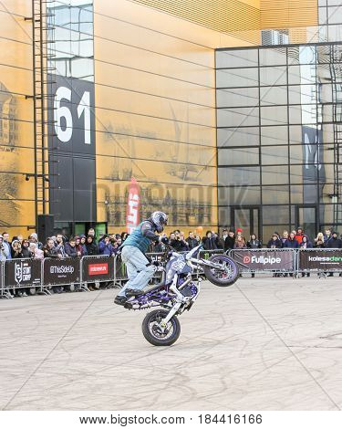 St. Petersburg Russia - 15 April, Doing the tricks on a motorcycle,15 April, 2017. International Motor Show IMIS-2017 in Expoforurum. Sports motorcycle show of bikers on the open area.
