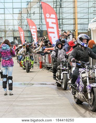 St. Petersburg Russia - 15 April, Greetings from the audience,15 April, 2017. International Motor Show IMIS-2017 in Expoforurum. Sports motorcycle show of bikers on the open area.