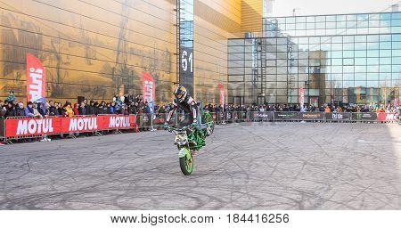 St. Petersburg Russia - 15 April, A trick on the front wheel,15 April, 2017. International Motor Show IMIS-2017 in Expoforurum. Sports motorcycle show of bikers on the open area.