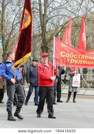 Kirishi, Russia - 1 May, People with flags at the May demonstration.,1 May, 2017. People at the May demonstration and rally in the Russian provincial government.