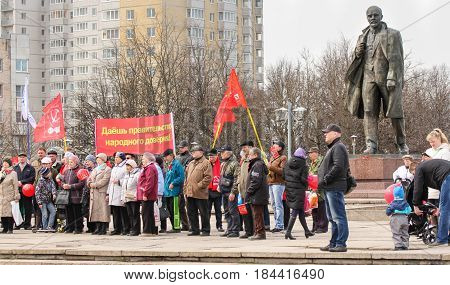 Kirishi, Russia - 1 May, A group of people at the monument to Lenin,1 May, 2017. People at the May demonstration and rally in the Russian provincial government.