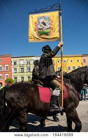 Tittmoning,Germany-April 30,2017: A rider carries a banner from a local society at the annual St.George's parade