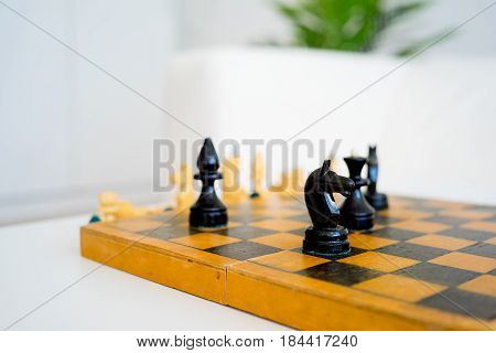 Chess set with the chess board on a table
