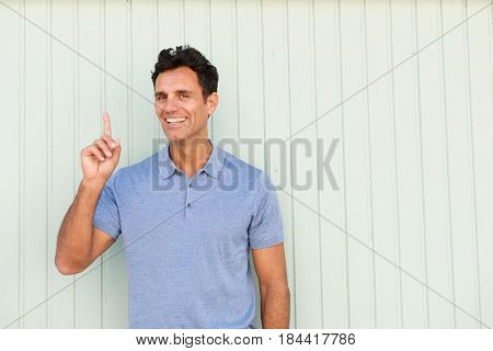 Smiling Middle Age Man Pointing One Finger