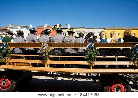 Tittmoning,Germany-April 30,2017:A carriage with a bavarian brass band drives by at the Annual St.George's parade