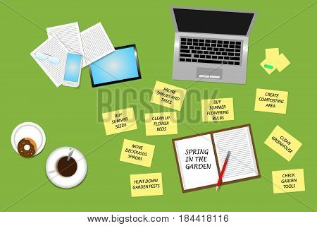 Trendy green office desk top view with supplies coffee cup and donut. Around the open notepad with the Spring in the garden sign are a yellow notepads with the task you need to do in the spring garden.