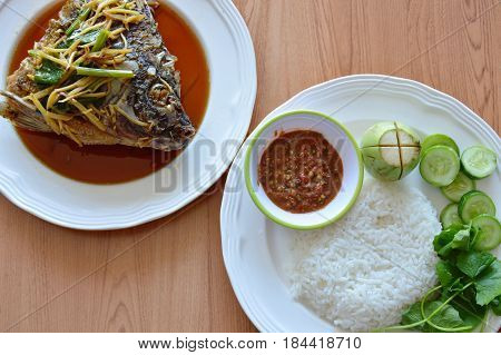 fried fish head dressing ginger soy sauce eat with rice and spicy shrimp paste sauce