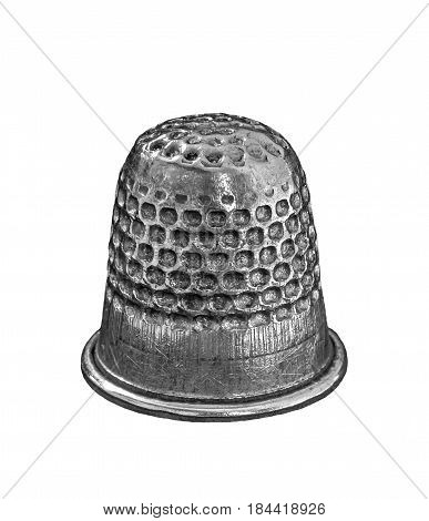Silver thimble isolated on white background .