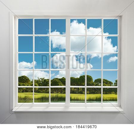 Modern residential window with lake and forest view