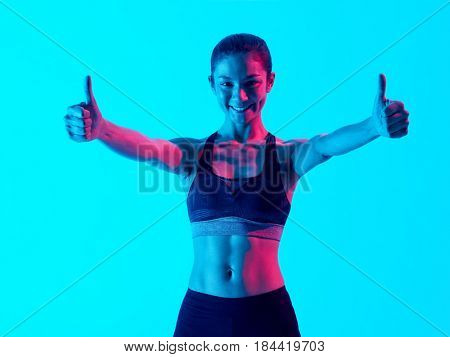 one mixed races woman exercsing Thumbs Up fitness exercices isolated on blue blackground