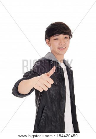 A handsome Asian man standing gesturing with his thump up in a gray jacket isolated for white background.