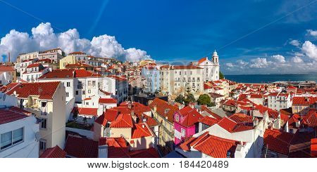 Panormic view of Alfama, the oldest district of the Old Town, with Igreja de Santo Estevao on the sunny afternoon, Lisbon, Portugal