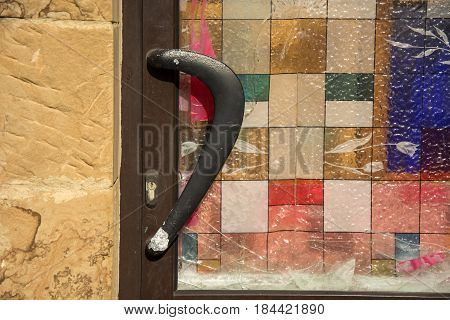 Photo of a door detail with several colours and sunlight