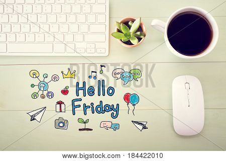 Hello Friday concept with workstation on a light green wooden desk