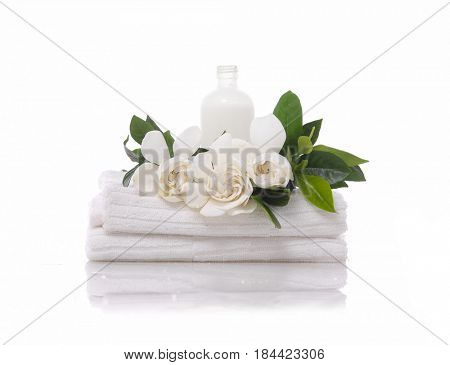 gardenia with and oil on towel –white background