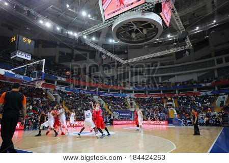 MOSCOW - JAN 27, 2017: Referee and teams during basketball game CSKA (Moscow) - Anadolu Efes (Istanbul) in Megasport stadium