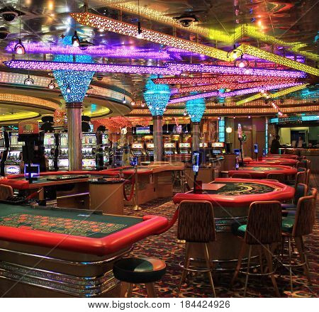Cruise ship Voyager - May 4, 2017: Poker table and gaming slot machines in American gambling casino of liner Voyager.
