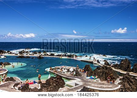 Madeira, Portugal - May 2, 2017: Natural pools in resort Porto Moniz, Madeira island, Portugal