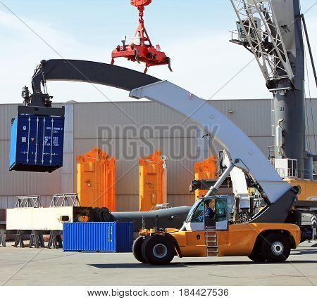 Rostock, Germany - May 1, 2017: Container loader - reach stacker in the test area of Liebherr crane building factory, Rostock, Germany.