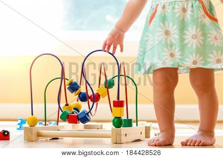 Toddler Girl Playing With Colorful Toys