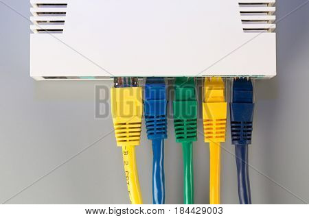 Office router connected to five multi-colored patch cord with connectors RJ45. Above view