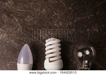 LED bulb incandescent lamp fluorescent lamp on a dark marble background. To save energy innovation. Eco innovation concept. Innovation idea. New innovation