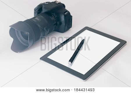Photographer Workspace On White Table, Tablet And Camera White Screen.