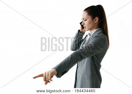 Businesswoman talking on the phone and giving directions